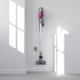 Picture of a cordless vacuum in a wall-mounted charging unit