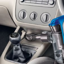 Picture of a handheld Dyson cleaning the interior of a car