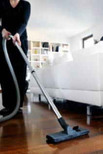 Picture of a woman vacuuming a wooden floor