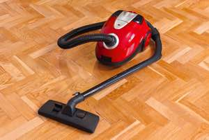 Picture of a cylinder cleaner on a wood floor